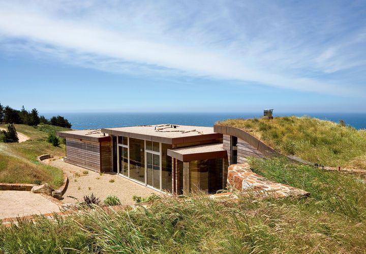 """I've been all around the world, and whenever I come back here, I realize that the Pacific Ocean seen from those cliffs is the most beautiful view on earth,"" says the resident of this house built into a hillside in Big Sur, California.  Courtesy of © Robert Canfield (415) 472-1302."