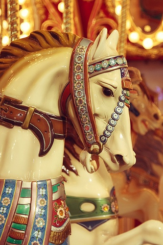 Carousel Horse.  These Carousel/merry-go-round horses are hand carved and painted in fancy trappings, saddle blankets, flowers, armor, saddles with western motif's.