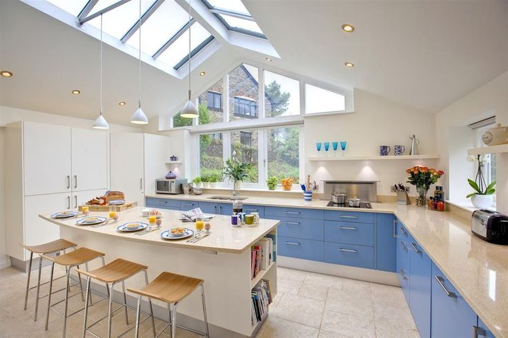 The light and airy modern kitchen at Binham Cottage, Dittisham.    Sleeping 11 guests, this fabulous property provides beautiful accomodation for a large family gathering in one of South Devon's most picturesque coastal villages.