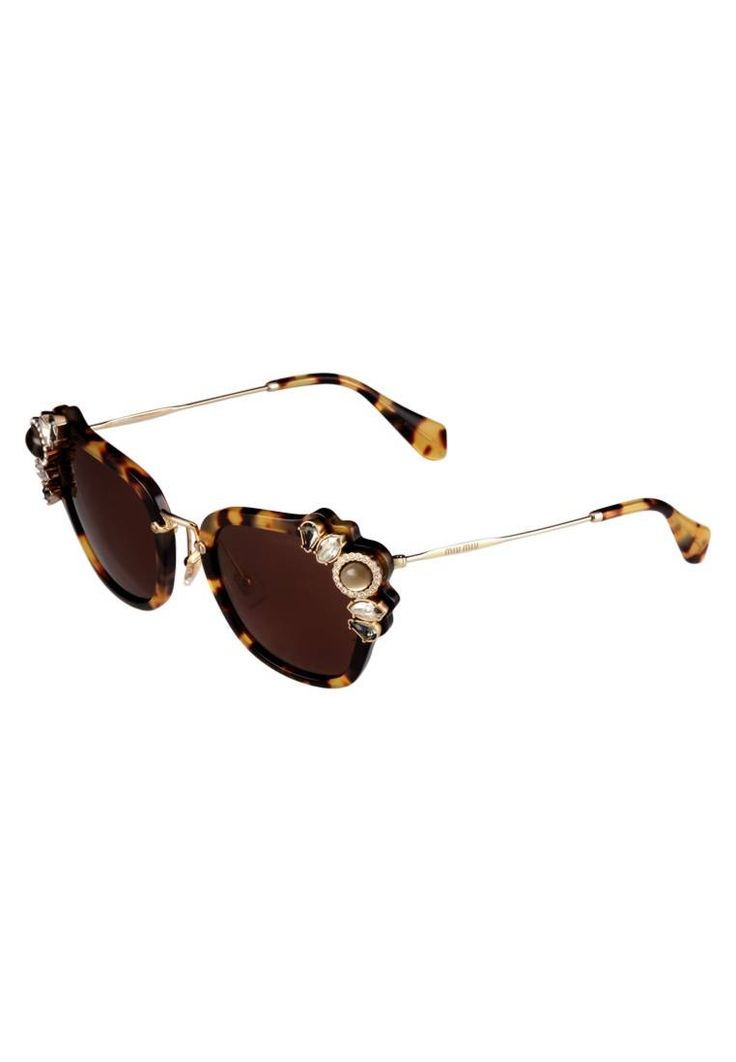 Miu Miu. Occhiali da sole - mottled brown. #occhialidasole #sunglasses #zalandoIT #fashion #moda Portaocchiali:Sacchetto con coulisse,Custodia rigida. Forma occhiali:Farfalla. Protezione UV:Sì. Astine:14 cm nella taglia 51. Ponte:2 cm nella taglia 51. Larghezza:14 cm nella taglia 51
