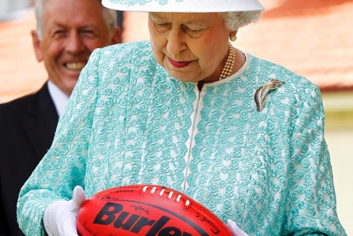 The Queen with an Australian Rules Football :-)