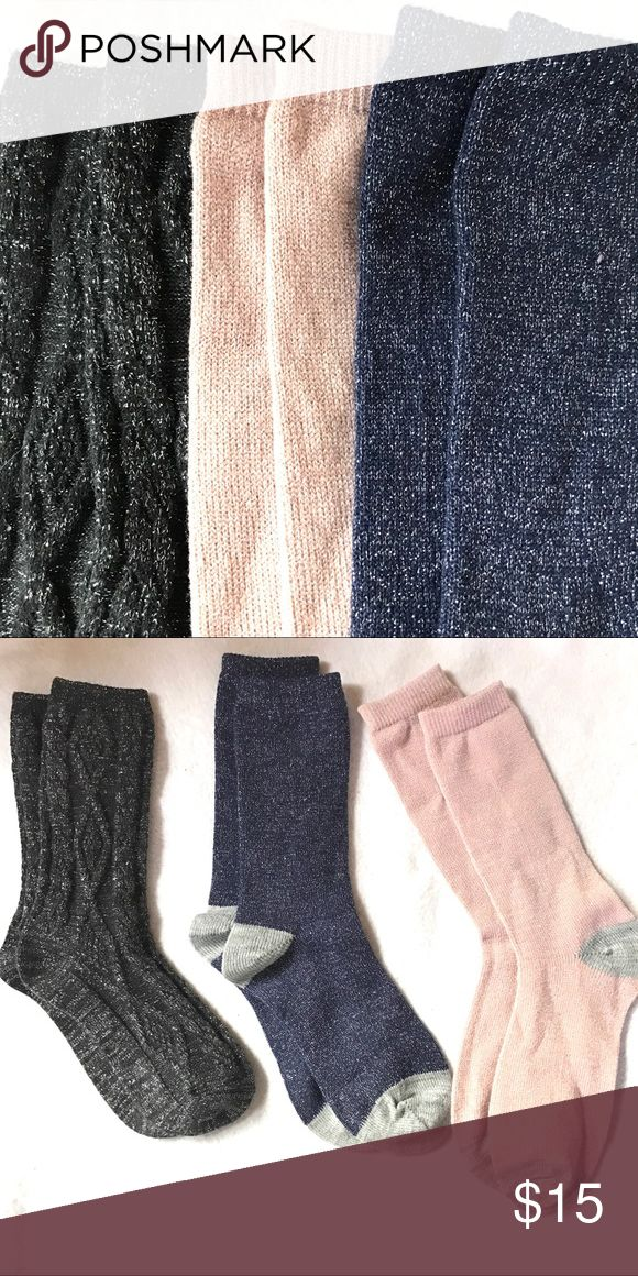 """NWOT LOFT Gray Pink Black Navy Blue Metallic Socks New without tags set of Metallic socks in pink, gray, black, navy blue.   Black pair is cabled and from Ann Taylor LOFT.   I believe the other 2 pair are as well but not 100% sure.  All have been washed but never worn.   Listing includes all 3 pair.  Regular ladies size.    Approx height from top of heel to top of sock: pink 8"""", black 7.5"""", navy 7.25"""". LOFT Accessories Hosiery & Socks"""