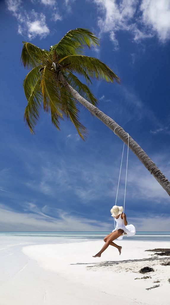 Swinging from a palm tree wearing a straw hat is our idea of a wonderful vacation. www.iberostar.com