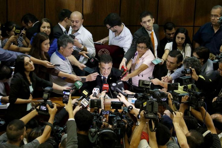 <p>President of the Senate Chamber of Paraguay, Roberto Acevedo (C), talks with the media announcing the suspension of the session for 30 March 2017 at the National Congress building in Asuncion, Paraguay, 28 March 2017. Senators in favor of a constitutional amendment to allow ex-presidents to run for re-election called for an extra session on Tuesday to change the internal rules of the chamber. (AndrÈs Cristaldo/EPA) </p>