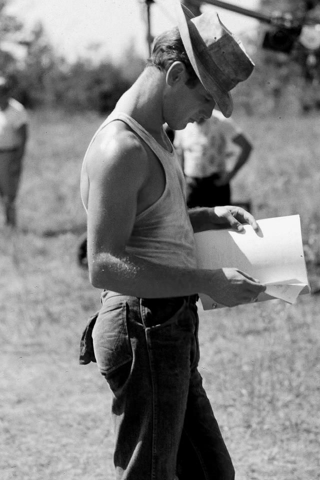A young, handsome Paul Newman reading a script.