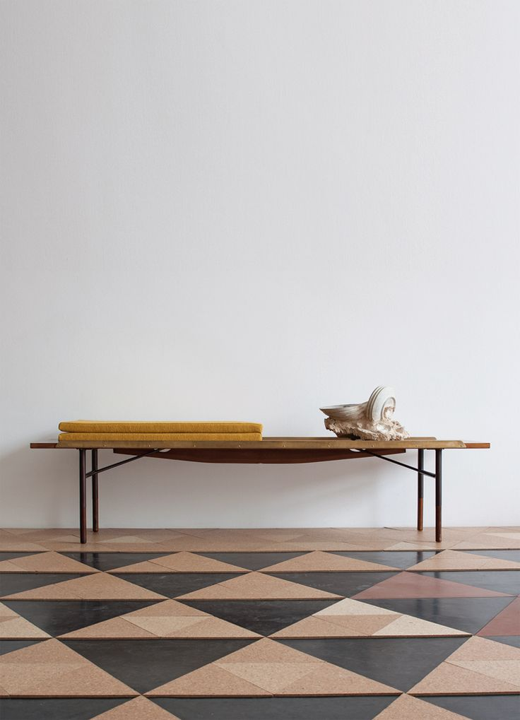 A Bench or a Table – used for both, designed by Finn Juhl for BOVIRKE in 1953, as part of a series of furniture with a simple steel frame in burnished steel. The Bench is in the design family with furniture such as the Nyhavn Table and FJ Sideboard. Patterned floor with a mid-century modern feel.