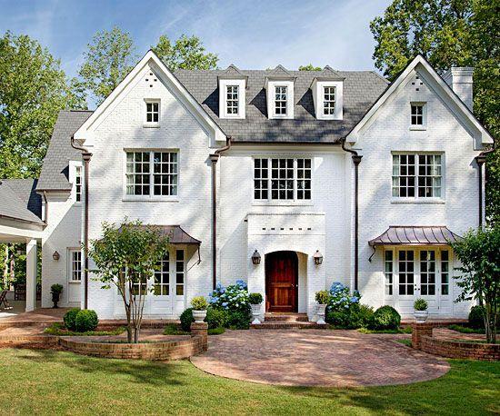 Tudor Influence.  Love the simple facade with big windows.  Looks very classic.