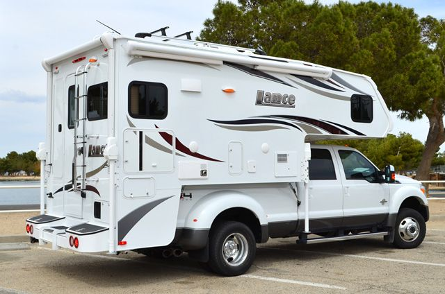 Lance Campers debuts the 2016 Lance 975, a ten-foot, four-inch truck camper with a full-wall slide out and a dry bath. Lance also teases a new model.