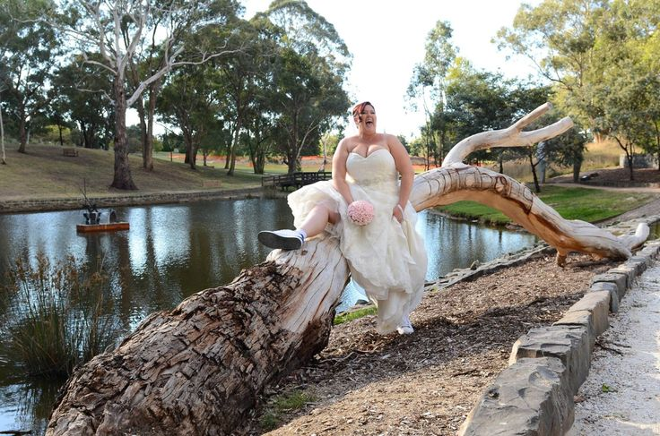 Candid Photos of a Lifetime -  The bride just having a rest on a tree branch  www.candidphotosofalifetime.com.au