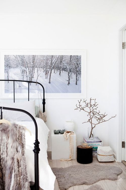 Scandinavian style bedroom bare branch arrangement for White fur bedroom