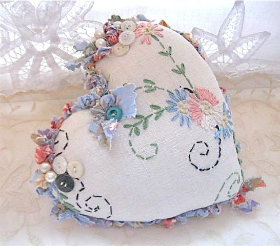 Upcycled vintage linens in an embellished heart pincushion.....what a great idea