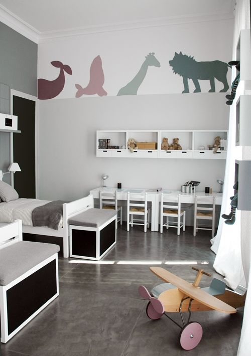 The dusky colours of the animal decals against white matched with a subtle grey wall and bold black and white furniture makes for fun as well as charmingly contemporary chic bedroom.
