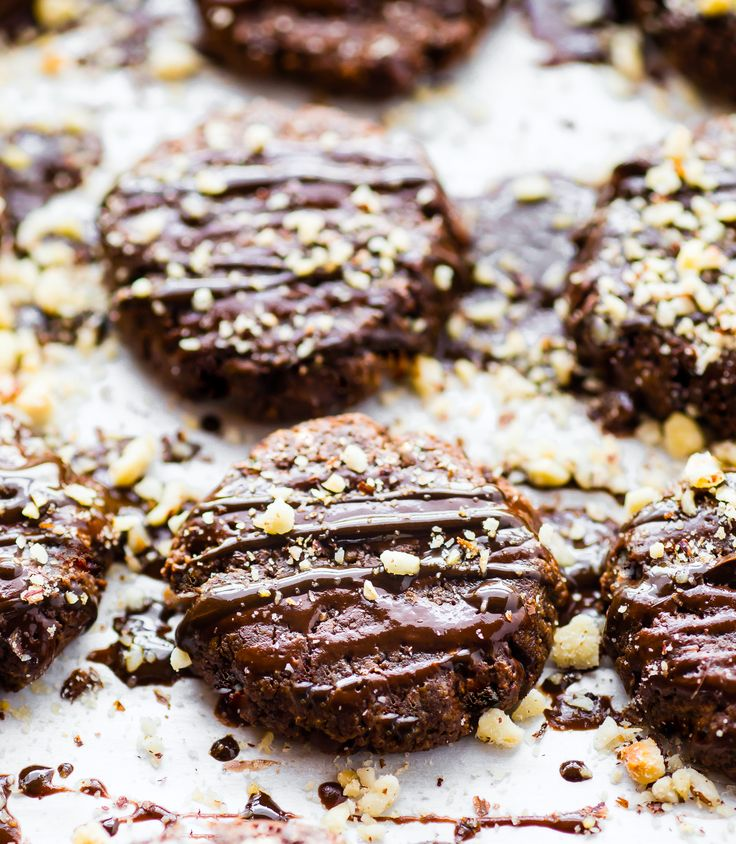 Vegan Chocolate Hazelnut Breakfast Protein Cookies made with just a few simple Ingredients! These protein cookies are packed with real food and plant based protein! Vegan, flourless, and tastes like dessert. A chocolate protein cookie you're totally allowed to eat for breakfast.