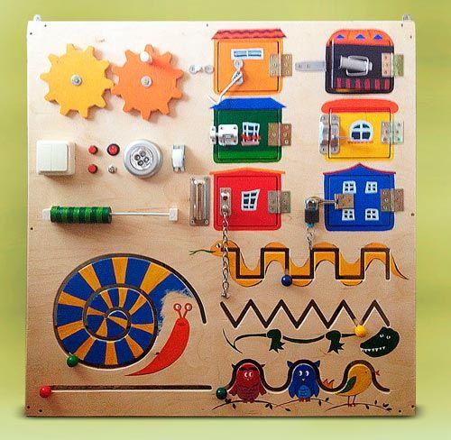 Бизиборд - развивающая доска с замочками и кнопочками для малышей своими руками