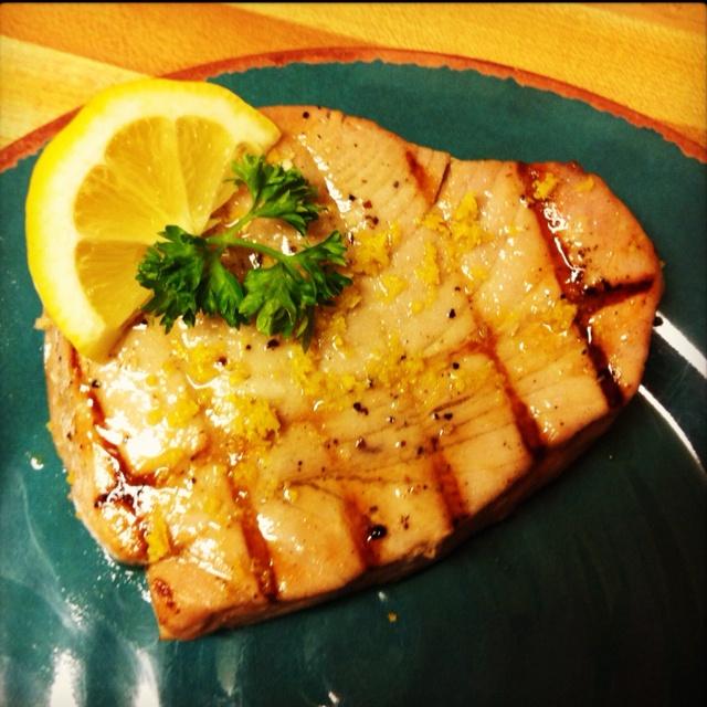 Lemon Garlic Tuna Steaks  Marinade: 1/4c lemon juice, 1T veg oil, 2 garlic cloves minced, 1/4 tsp salt & pepper. Place in ziploc bag w/ tuna steaks. Marinate up to an hour. Grill. Top w/ parsley, lemon zest & lemon wedge.