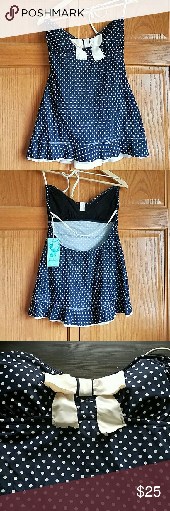 Nwt Polka dot one piece New, with tags, polka dot Navy and White pin up style one piece. Low back, cut bow in front. Eco Swim Swim One Pieces
