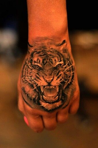 The 25 best tiger hand tattoo ideas on pinterest lion for Animal hand tattoos