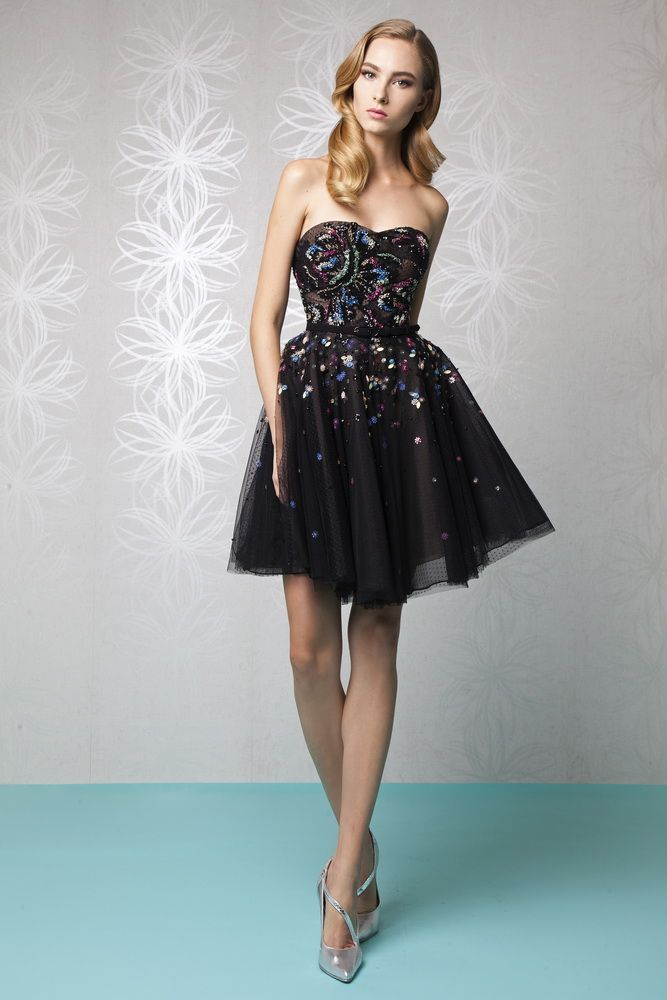 Style 44   Short princess sweetheart dress in Black Tulle embellished with multicolored embroidery and a belted waist.