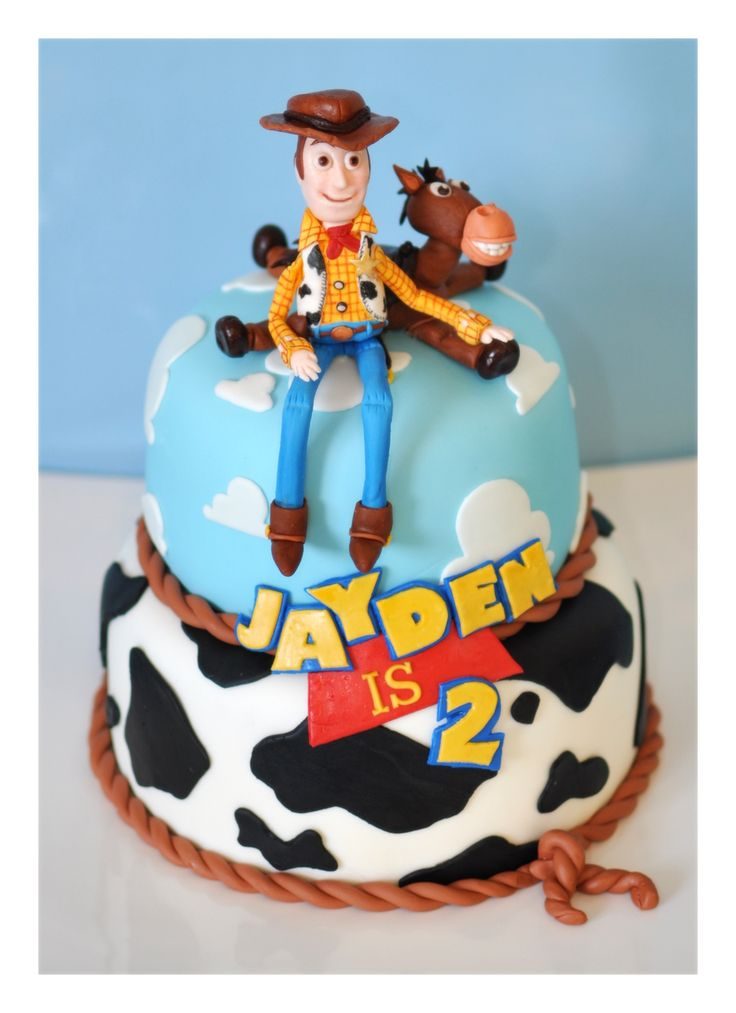 Toy story cake.  Handmade fondant/gumpaste Woody and Bullseye and hand...