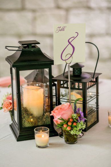 varying size lanterns give added glow & volume to table centerpieces. add a few small floral accents and votives and whola... a great look.
