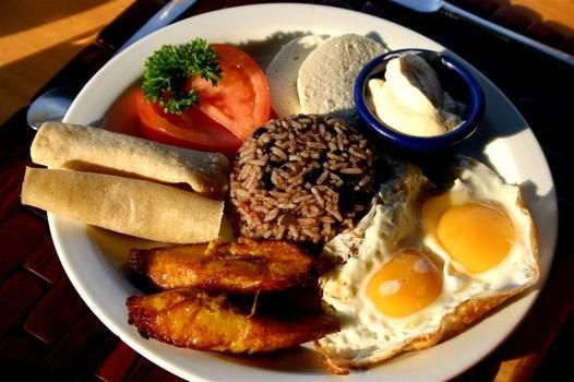 Costa Rican breakfast with gallo pinto, plantains, eggs and natilla.