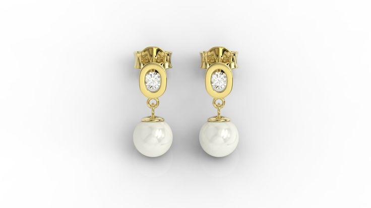 Złote kolczyki z perłą./Gold earrings with pearl.