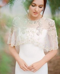 bride with lace and beaded jacket for a spring or summer wedding @myweddingdotcom