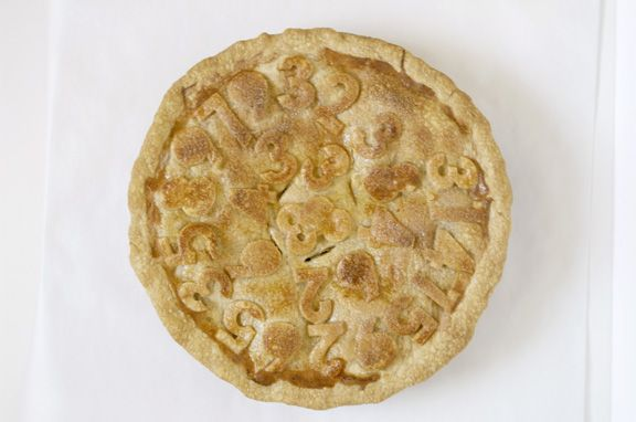 Celebrate Pi Day!  Pi = 3.1415926535…    Apple pi    clever apple pie where the fruit and crust adornments are cut into numbers.    Pi, Greek letter (), is the symbol for the ratio of the circumference of a circle to its diameter. Pi Day is celebrated by math enthusiasts around the world on March 14th.