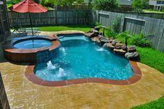 Cute backyard pool, spa, waterfall, and stampcrete deck - LOVE it