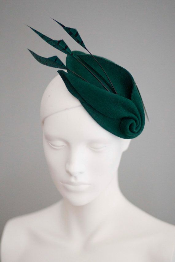Louisa is a unique and dramatic cocktail hat made from high quality wool felt. The hat has been hand sculpted into its unique shape then