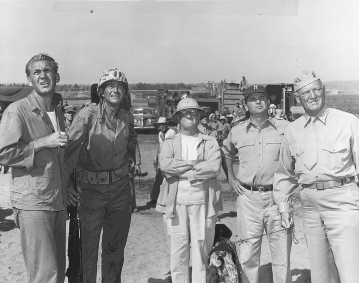 Actors Forrest Tucker and John Wayne director Allan Dwan Major General Graves Erskine and others during the filming of the movie Sands of Iwo Jima 1 January 1949.