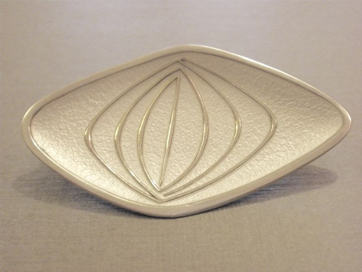 O.F.Hjortdahl, a silver and enamel brooch, Norway, circa 1960, stamped symbol for Olaf Fritjof Hjortdahl, '925S', Sterling', 'Norway', of slightly concave form, 4.9 cm…
