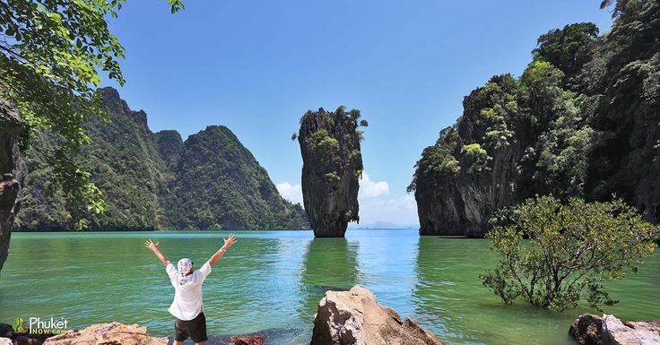 The enthusiastic tourist is stunned by beauty of island-vase in shallow lagoons. The magnificent island of James Bond