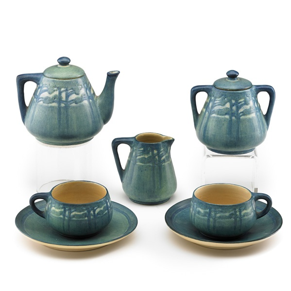 NEWCOMB COLLEGE  Rare seven-piece Transitional tea set for two with pine trees, New Orleans, LA, 1911: two teacups and saucers, teapot, sugar pot, and creamer