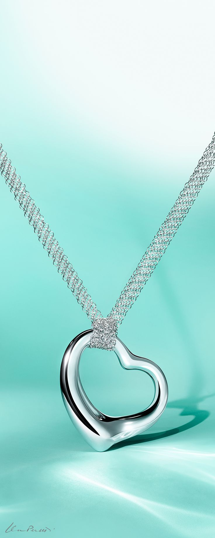 This Christmas, all you need is love. Elsa Peretti® Open Heart pendant in sterling silver on a mesh chain.