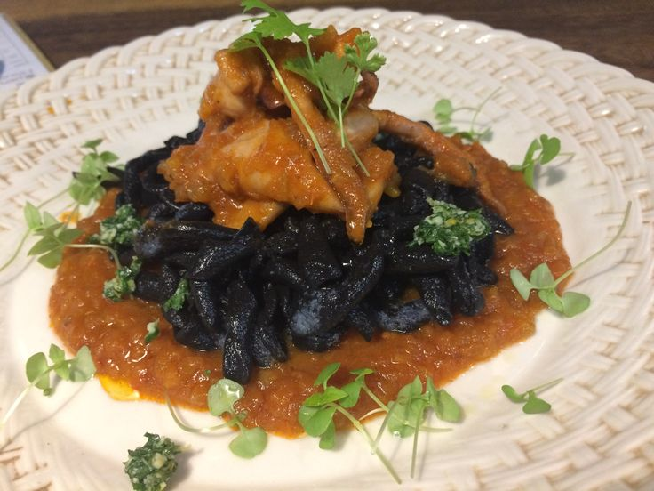 New dish at The Open House restaurant BRAISED CUTTLEFISH & BLACK INK FUSILLI, house-made black ink fusilli with sliced cuttlefish braised in tomato, white wine sauce & geremolata.
