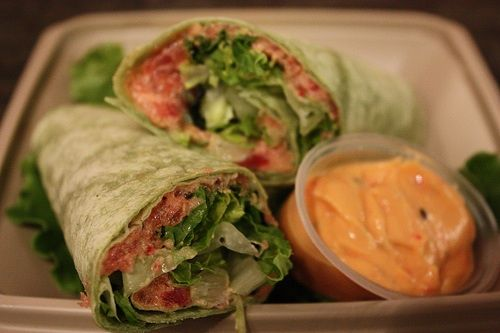 spicy tuna wrap!  - i make mine with cooked tuna, pear slices, spinach, and rice krispies for extra crunch