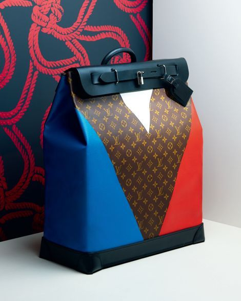 Louis Vuitton Structured Bag with classic monogram print and blue, red, and black details @Coveteur