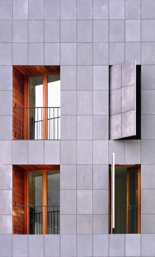 H Arquitectes - The exterior coating of the shutters consists of VIROC panels made up of cement and wood fibres which have similar colour and texture as the basalt stone of the façade though it is a much lighter material and withstands the impacts by opening or closing the shutters.