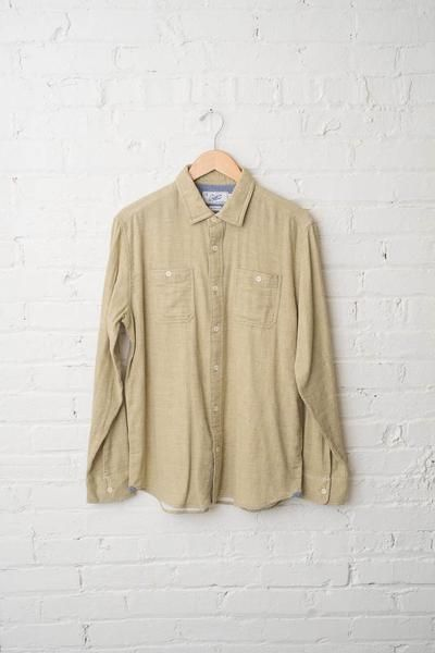 A soft, light green double cloth herringbone shirt with cream buttons and two buttoned front pockets. - 100% Cotton - Machine wash warm with like colors - Fits true to size - Size medium shown