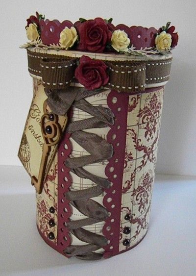 altered oatmeal container...could change up colors... Love this for like a memory box or something :)