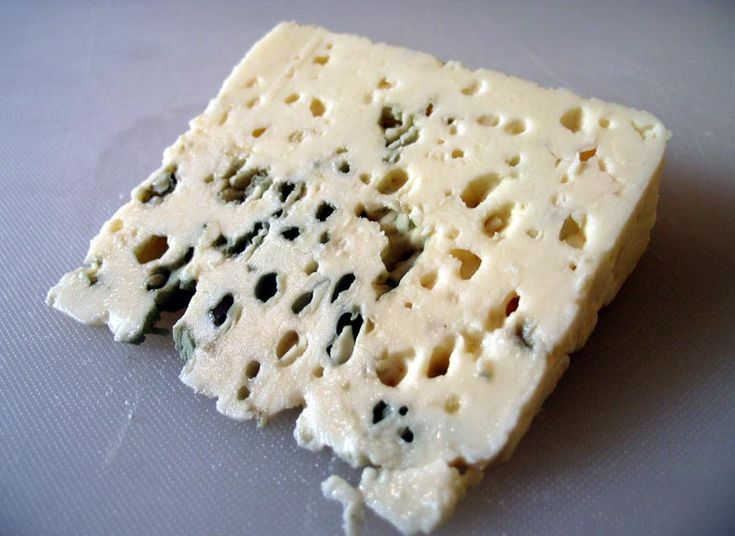 Roquefort - Roquefort is a popular French cheese, reported to be a favorite of Emperor Charlemagne. In France, it is called the 'cheese of kings and popes'. This cheese is protected by AOC guidelines. Roquefort cheese is moist and breaks into little pieces easily. Genuine Roquefort is rich, creamy and sharp, tangy, salty in flavor. It is aged for 5 months. It is also mostly used in salads and dressings.