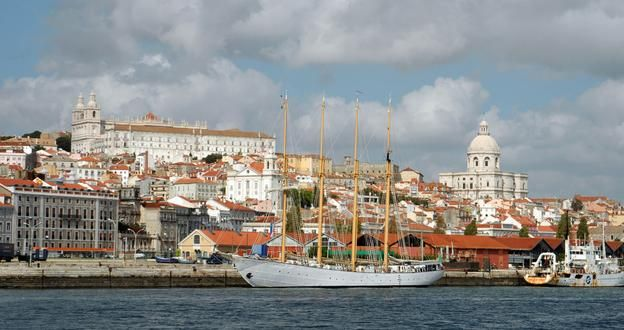 Some of the most popular neighbourhoods to live in are those close to the Tagus River and the Alfama district, pictured here. (BBC)