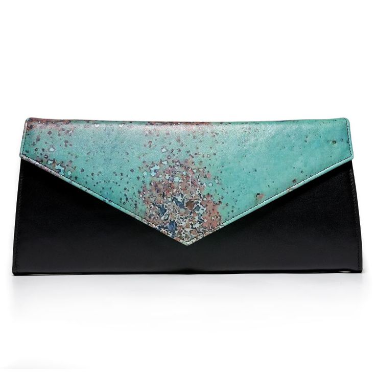 Rust inspiration clutch. Made from a mix of natural leather and printed leather.