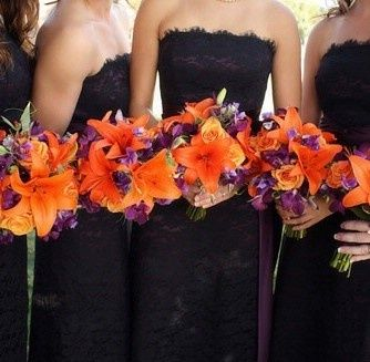 Purple bridesmaid dresses with an accentor orange in the flowers! Love it!