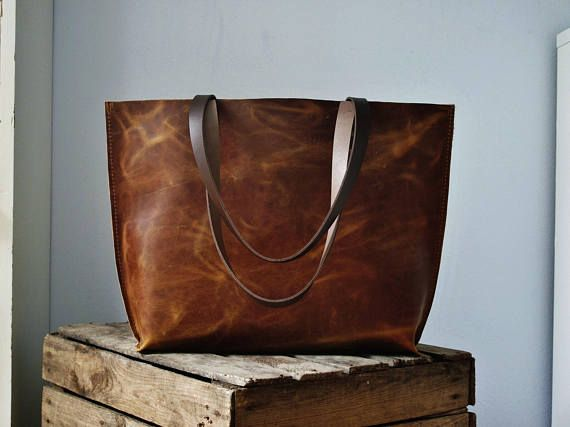 Gorgeous brown leather tote bag: perfect for use as a stylish shopper or generously-sized day bag.  Made with a quality, pull-up leather, medium thick (1.5mm), semi-rigid and very robust. It lightens in color when bent or scratched, giving it that antique look and those pretty shades of brown. - Natural suede lining, with triple stitched seams at the base corners. - Sturdy brown leather handles and antique-look rivets. - Optional canvas zipper pocket for your phone/valuables.  ***Dimensi...