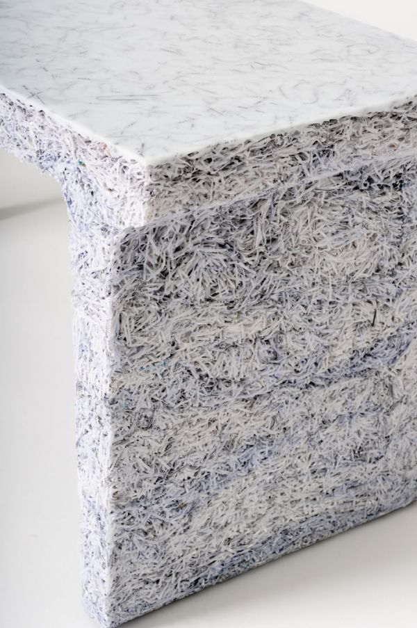 Belgian industrial designer Jens Praet uses shredded magazines and documents mixed with clear resin.