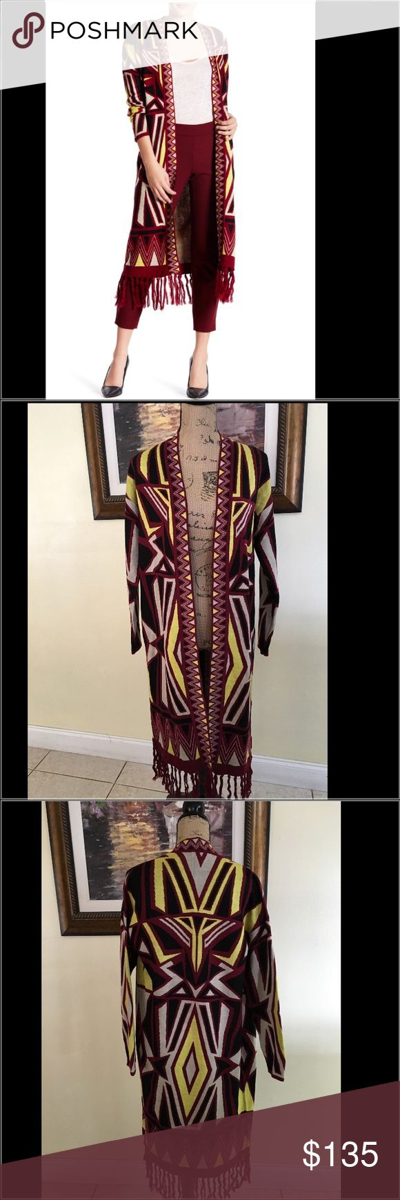 Romeo + Juliet Couture Printed Long Cardigan Romeo + Juliet Couture Printed Long Cardigan.  New with tags.  Love this fringed cardigan.  The colors are so lively and beautiful!  Mix of burgundy, black, yellow and khaki. Romeo & Juliet Couture Sweaters Cardigans