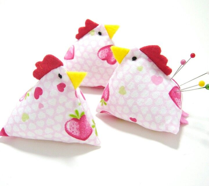 Pincushions - cluck, cluck.  Looks simple to make.  Basically little pyramids with felt beaks and cockscomb.