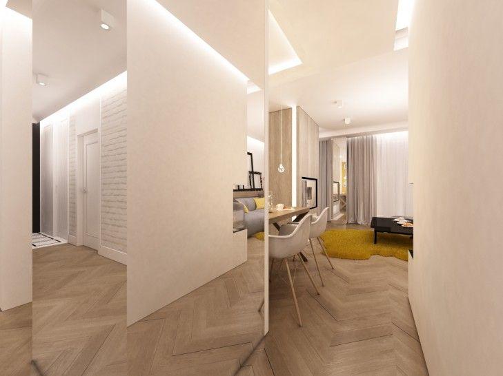 Po środku salonu zaprojektowany kubik z luster powiększa optycznie i doświetla wnętrze.  http://www.tissu.com.pl/zdjecia/186